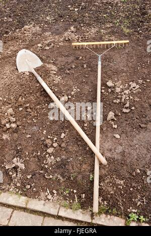 Tools on the ground in the Vegetable Garden at Rosemoor - Stock Image