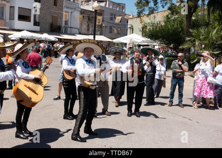 Guitar playing band street performance at a spanish festival - Stock Image