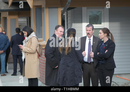 Maple Ridge, B. C. March 25, 2019.Canadian Prime Minster Justin Trudeau in Maple Ridge to address the media on affordable housing. Security staff. - Stock Image