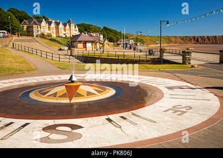 UK, England, Yorkshire, Filey, promenade, fishing areas points of the compass fountain beside sea - Stock Image