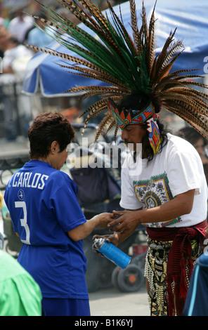 Aztec Shaman Performing a Spiritual Cleansing Ritual on a Woman, Zocalo Square, Plaza de la Constitucion, Mexico - Stock Image