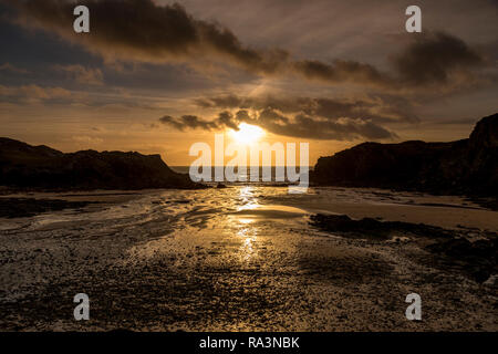 Sunset over the sea at Porth Dafarch, Anglesey, North Wales - Stock Image
