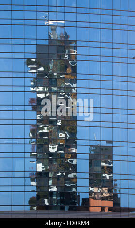 Reflection of the Bosco Verticale (Vertical Forest) residential towers in the Porta Nuova district in Milan, Lombardy, - Stock Image