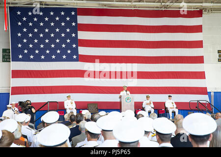 """180824-N-IK388-0033 NORFOLK (Aug. 24, 2018) Chief of Naval Operations Adm. Johnathan Richardson, center, addresses guests aboard the nuclear aircraft carrier USS George H.W. Bush (CVN 77) as Vice Adm. Andrew """"Woody"""" Lewis assumes command of U.S. 2nd Fleet. U.S. 2nd Fleet will exercise operational and administrative authorities over assigned ships, aircraft and landing forces on the East Coast and North Atlantic. (U.S. Navy photo Mass Communication Specialist 2nd Class Stacy M. Atkins Ricks/Released) - Stock Image"""