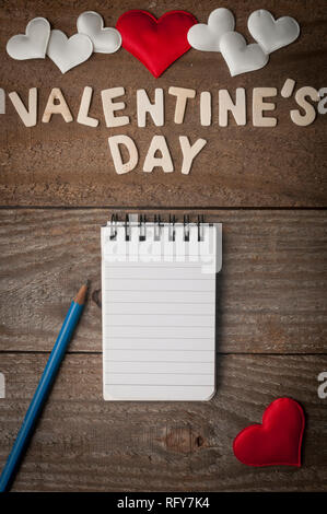 Valentine's day background with a paper notes with copy space - Stock Image