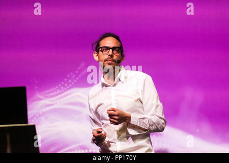 Neuroscientist Chris Timmerman explainibng how psychedelic drugs have been used to explore human consciousness, on the Humans Stage, at New Scientist Live - Stock Image