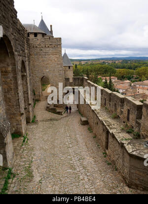 The fortified walls of the city of Carcassonne on the Aude River and Canal du Midi, southern France - Stock Image