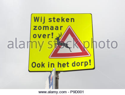 Zandvoort The Netherlands  Sign warning for Fallow Deer (Dama dama) graze in the village. The deer are part of the fauna in the dunes which run along  - Stock Image