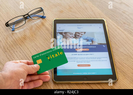 Paris, France - November 15, 2018 : French health insurance website, presenting the new 'shared medical file'(DMP), on a digital tablet. - Stock Image