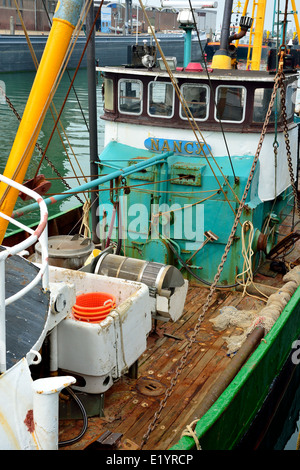 Fishing boat for North Sea shrimps close up installation and nets - Stock Image