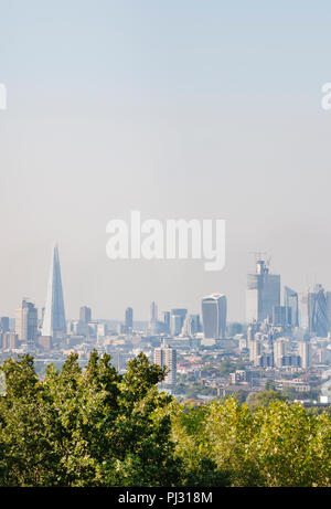 View of City of London skyline from One Tree Hill, Honor Oak, Southwark, London, United Kingdom - Stock Image