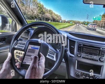 Texting and driving - Stock Image