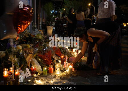 Toronto, Canada. 25th July 2018. After deadly mass shooting on Toronto Danforth Greek Town on July 22, 2018, people are leaving flowers, candles and message in one of the shooting location - Demetres Danforth Cafe where a 10-year old girl was shot and killed Credit: CharlineXia/Alamy Live News - Stock Image