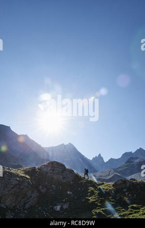 Hiker going up to peak of rock, Mont Cervin, Matterhorn, Valais, Switzerland - Stock Image