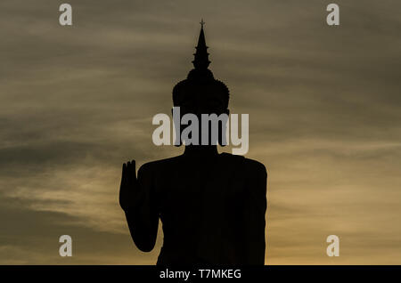 A statue of Buddha at sunset, Oudomxay, Laos - Stock Image