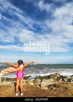 Freedom!!! Litlle girl in front of sea. - Stock Image