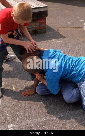 bullying in the playground - Stock Image