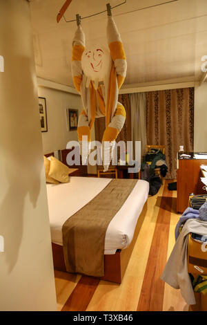 A decoration made from towels in a bedroom or cabin on board a cruise ship - Stock Image