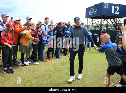 19th July, Portrush, Country Antrim, Northern Ireland; The 148th Open Golf Championship, Royal Portrush, Round Two ; Jordan Spieth (USA) acknowledges a young fan as he walks from the 13th tee - Stock Image