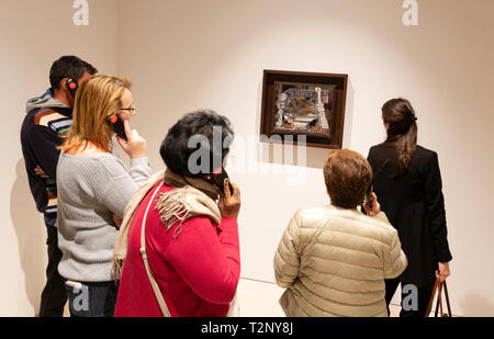 Picasso Museum Malaga interior - people looking at 'Restaurant Paris Spring 1914', Museum of Picasso, Malaga Spain - Stock Image