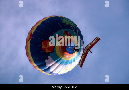 Hang glider suspended beneath a hot air balloon Chateau D Oex Switzerland - Stock Image