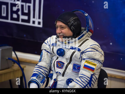 Expedition 51 Soyuz Commander Fyodor Yurchikhin of Roscosmos smiles at friends and family after having his Russian - Stock Image