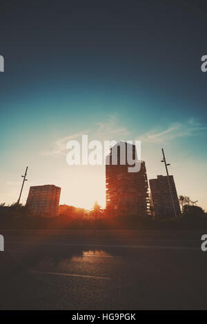 Dramatic red scenery of three residential houses and part of highway in front , Barcelona district Forum, evening - Stock Image