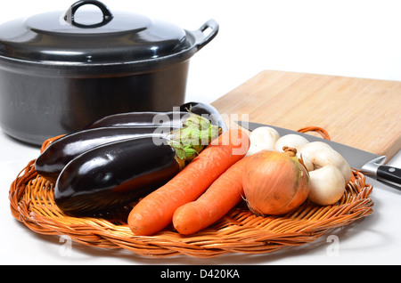Vegetarian cooking with home grown vegetables on white - Stock Image
