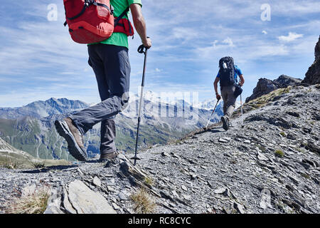 Hikers on ridge, Mont Cervin, Matterhorn, Valais, Switzerland - Stock Image