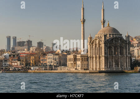 The Ortaköy Mosque, on the European Side of the Bosphorus in Istanbul.  New high-rise buildings under construction - Stock Image