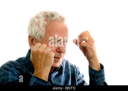 A man in his 60's showing anger or frustration - Stock Image