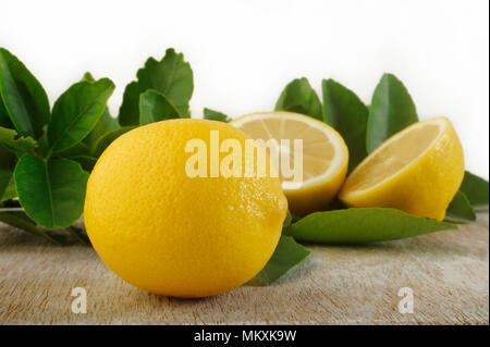 Fresh lemon on wooden background - Stock Image
