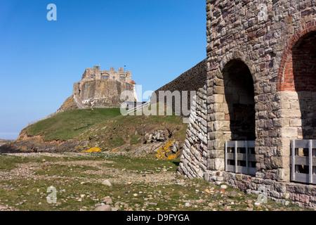 Lindisfarne castle and Lime Kiln on Holy Island, Northumberland, England - Stock Image