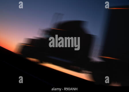Peterbilt Class 8 sleeper truck shilouted and blurred at sunset. - Stock Image