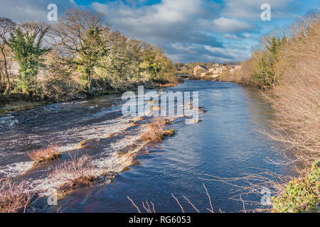 Teesdale landscape,  view of the river Tees upstream from The Demenses at Barnard Castle in winter sunshine and dramatic light - Stock Image