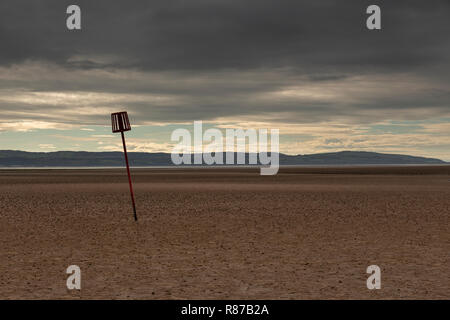 Marker post in the sand at West Kirby, Wirral, England - Stock Image