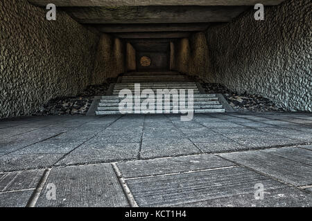 Light at the end of the tunnel, tunnel in need of some repairs - Stock Image