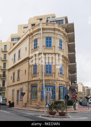 Street corner  architecture with a rounded building and blue window frames, offices of Lombard Bank Malta p.l.c., Sliema Malta - Stock Image