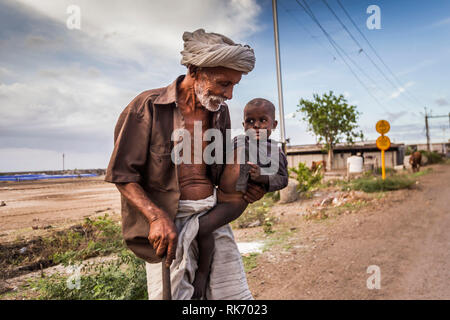 Indian old Man with child - Stock Image