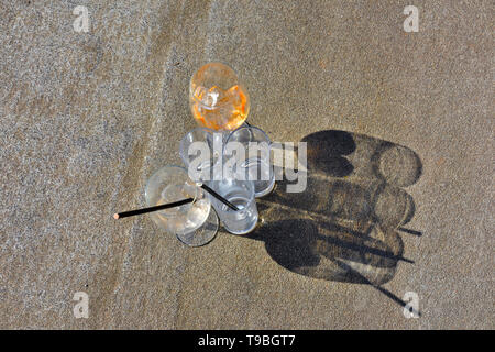 Empty drinks glasses casting shadows - Stock Image