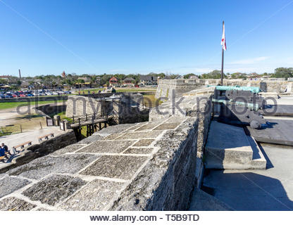 Cannons look through the ramparts at the Castillo de San Marcos, a Spanish fortification at St. Augustine, Florida USA - Stock Image