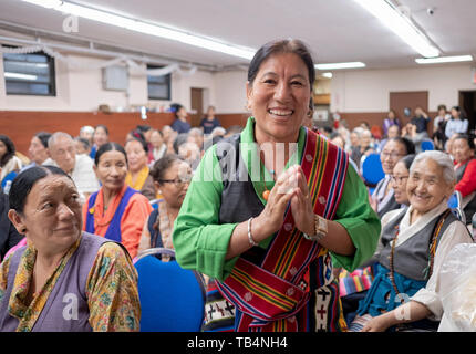 Posed portrait of a Nepalese performer at the Sherpa  Buddhist Temple in Elmhurst, Queens, New York City. She sang Himalayan music. - Stock Image