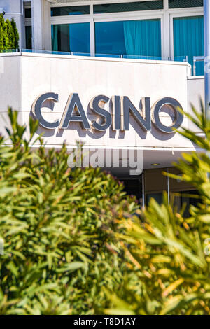 CANNES, FRANCE - APRIL 2019: Sign over the entrance to the casino at the JW Marriott hotel on the seafront promenade in Cannes. - Stock Image