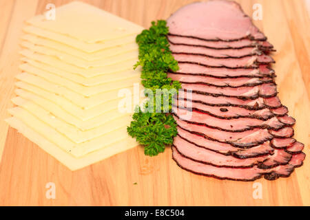 Sliced pastrami sandwich meat and swiss cheese - Stock Image