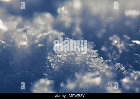 Close up of frost crystals growing on snow - Stock Image