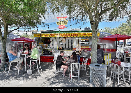 Food truck or trucks, with families or a family eating, at the beach resort town of Seaside, Florida USA. - Stock Image