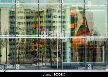 distortet reflection of a tower block in panes - Stock Image