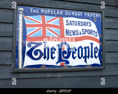 Old metal advertisement for the British national Sunday newspaper The People in the UK - Stock Image