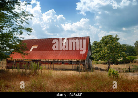 A barn with a red roof in a rural setting near Bloomington, Indiana, USA - Stock Image