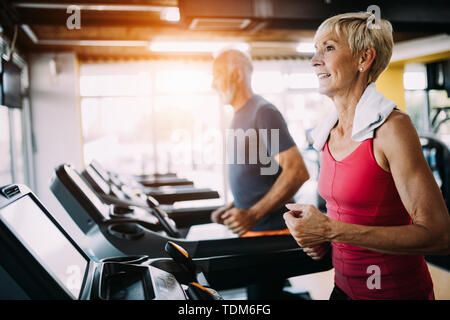 Image of attractive fit senior woman in gym - Stock Image
